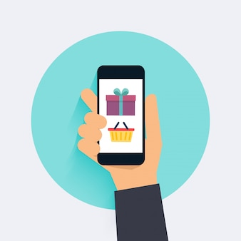 コンセプトオンラインショッピングとeコマース。モバイルマーケティングのアイコン。スマートフォンを持っている手。