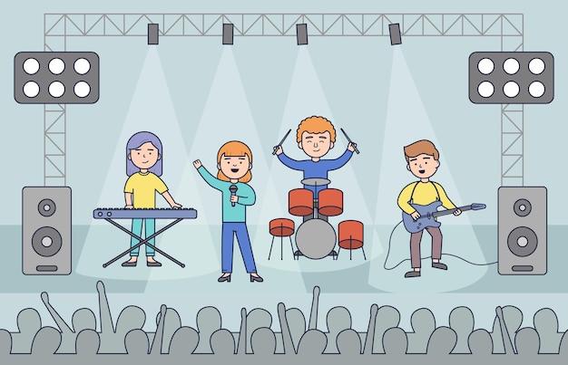 シーンミュージックステージの夜のコンサートポップグループアーティストと明るいナイトクラブのステージライトの前で若いロックメタルバンドが群がる