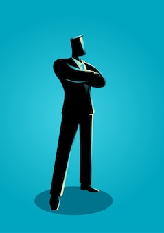 Confident business man standing with folded arms