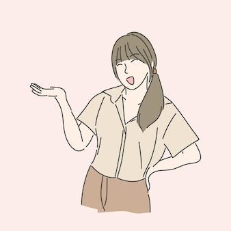 자신감이 소녀는 뭔가를 보여주기 위해 손을 올립니다.