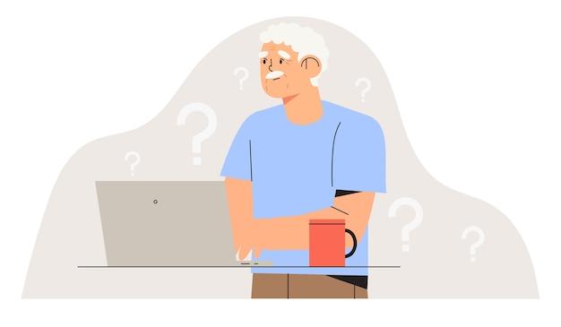 コンピューターと混乱した年配の男性。