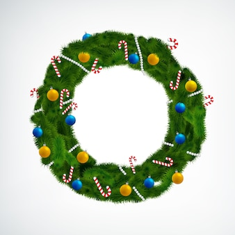 Coniferous christmas wreath decorated with balls and candies on white