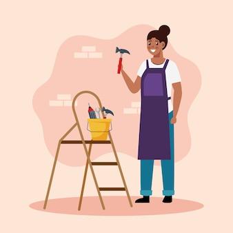 ハンマーとツールを持つコンストラクターの女性