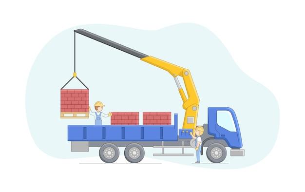 建設コンセプト。クレーンの運転手と労働者は一緒に働きます。マニピュレータクレーンは、パレット上のレンガを降ろします。機械オペレーターの仕事。仕事中のキャラクター。
