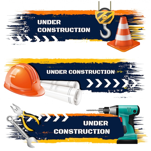 Under construction grunge banners with road barrier protective helmet hook of elevating crane realistic icons