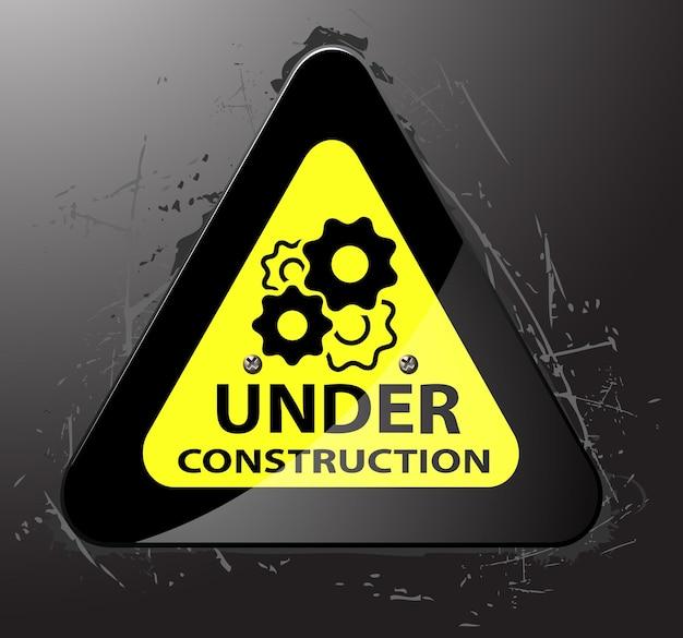 Under construction sign on grunge background vector illustration