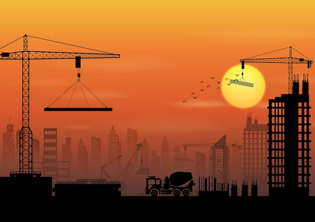 Construction site silhouettes at sunset