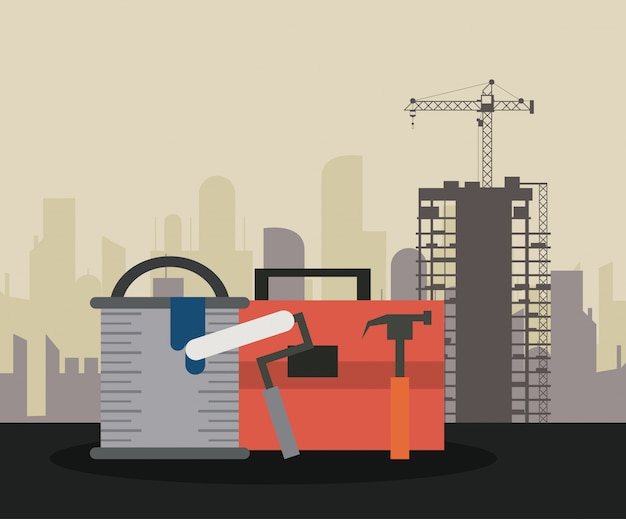 Construction tools over cityscape