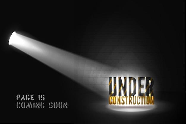 Under construction warning in spotlights on black background
