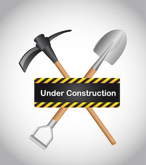 Under construction with shovel over gray background vector