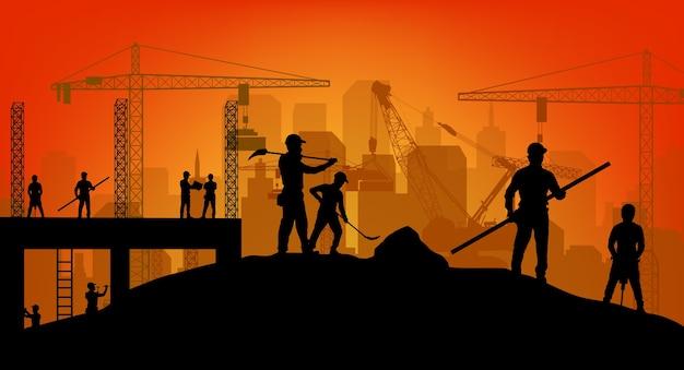 仕事の背景で建設労働者のシルエット