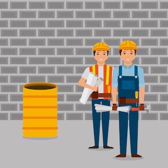 청사진 망치 배럴과 벽 벽돌을 들고 건설 노동자
