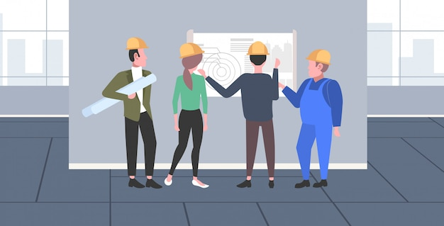 Construction workers studying blueprint engineers team discussing new building project during meeting industrial technicians teamwork concept modern apartment interior full length horizontal