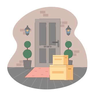Contactless delivery. some purchases in cardboard left at doormat. apartment entrance door with package.