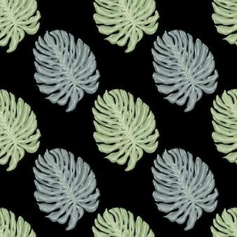 緑と青のモンステラの葉の飾りとのコントラストのシームレスなパターン。黒の背景。