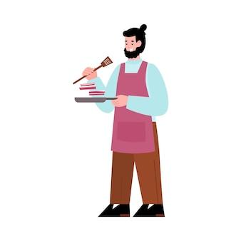 손에 프라이팬과 주걱으로 요리가 음식을 준비합니다.