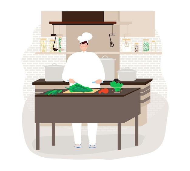 キッチンで人を料理する幸せなシェフがレストランで料理を準備する