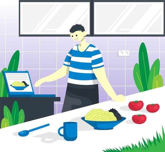 부엌 인테리어에 있는 테이블에서 요리사와 함께 요리하는 과정 인터넷에서 요리법 보기