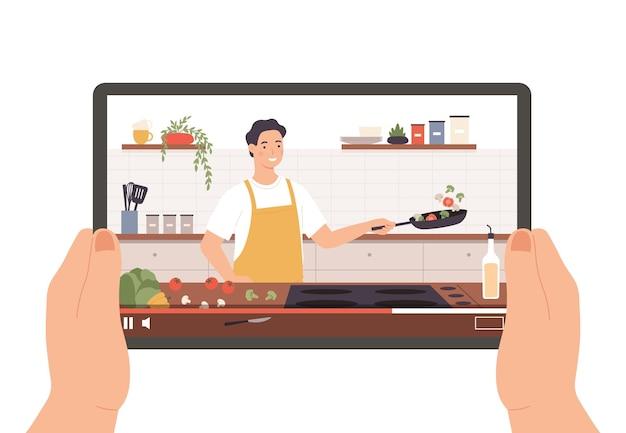 料理のビデオ。料理の放送、ショー、またはオンラインレッスンでタブレットを持っている手。シェフは、キッチンのインテリアベクトルの概念で料理を準備します。鍋に野菜を揚げるエプロンの男のキャラクター