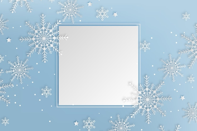 Copy space winter background in paper style and snowflakes