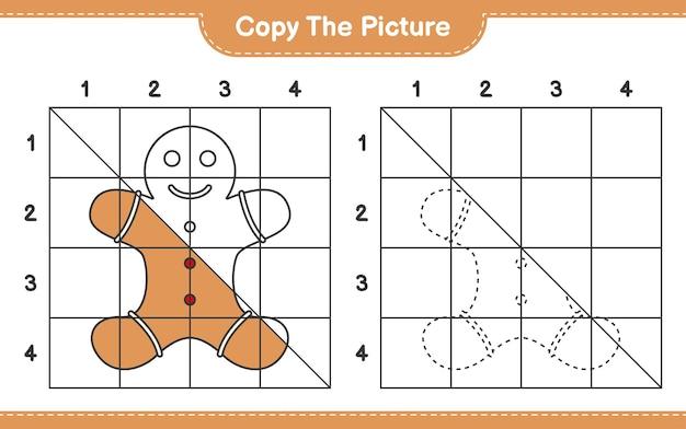 グリッド線を使用してジンジャーブレッドマンの絵教育ワークシートゲームをコピーする