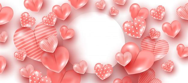 ピンクのハート形の白い丸いフレームの背景に風船。バレンタインデーのコンセプト。 copyspace、最小限のスタイルのバナー
