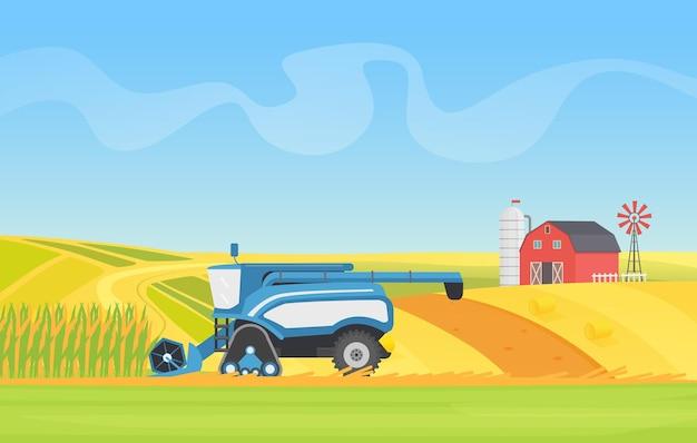 Комбайн для уборки кукурузы, работающий на сельскохозяйственных полях, выращивающих зерновые культуры