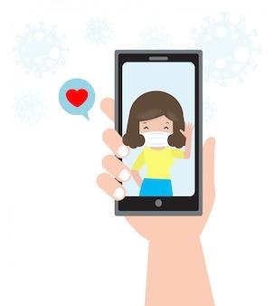 コロナウイルス2019-ncovまたはcovid-19スマートフォンでのコミュニケーションに人々のビデオ会議、スマートフォンを持っているカップルの人の手ビデオ通話、分離された長距離関係の概念