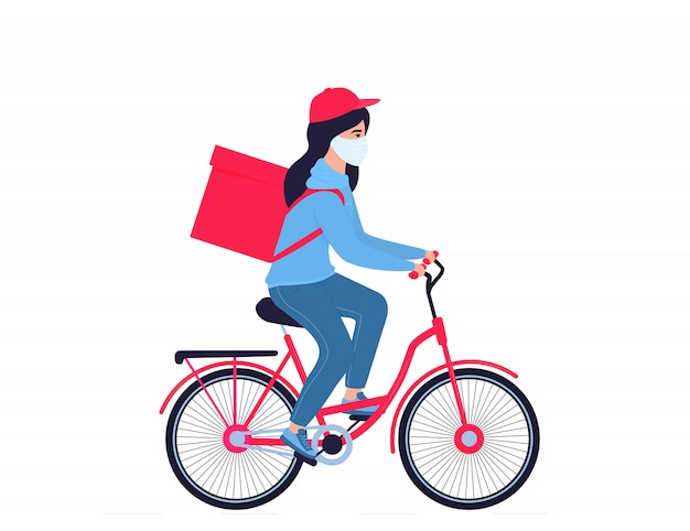 Coronavirus epidemic. delivery girl in a protective mask carries food on a bicycle. free shipping.