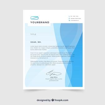 青い波状の企業パンフレット
