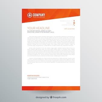 オレンジ色の企業パンフレット