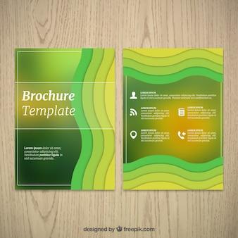 波状の緑の形状を有する企業のパンフレット