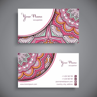 Corporate card decorated with pink mandalas