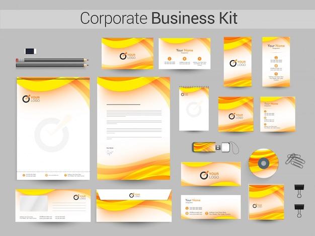 ビジネスのための黄色の波と企業のアイデンティティキット。 Premiumベクター