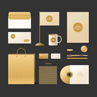 Corporate identity template. logo and design elements. golden style on a dark background.