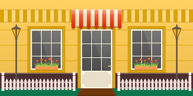 Уют деревня желтый дом фасадная улица. уютный внешний вид загородного дома с подъездом, окнами, лужайкой и деревянным забором. дизайн частной недвижимости квартиры украшены цветами мультяшный вектор