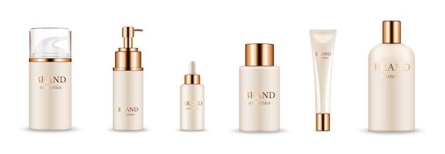 化粧品ボトル。美容液、クリーム、シャンプー、バームのリアルなゴールデンパッケージ。白い背景で隔離のベクトル化粧品のモックアップ。金色の帽子のイラスト化粧品