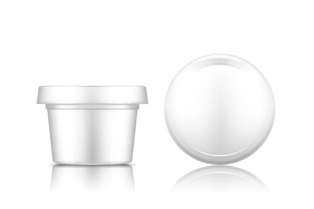 Whtieの背景に分離されたキャップトップビューモックアップと化粧品の瓶