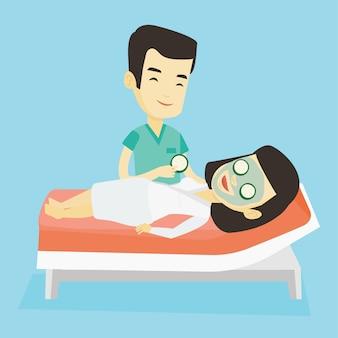 Cosmetologist making beauty treatments to woman.
