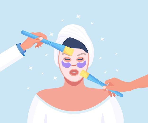 美容。スキンケアとアンチエイジング治療手順。にきびの毛穴のクリーニング、サロントリートメント。にきびの除去。エステティシャンが女性の顔に浄化フェイシャルマスクを適用