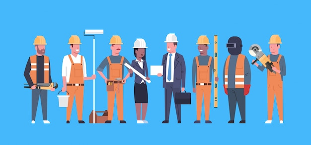 Costruction workers team industrial technicians mix race man and woman builders group