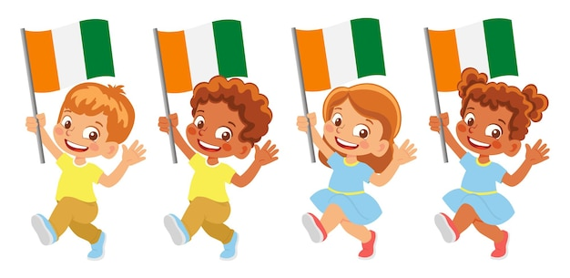 Cote d'ivoire - ivory coast flag in hand. children holding flag. national flag of cote d'ivoire - ivory coast