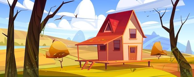Cottage nella casa di legno del paesaggio della foresta autunnale