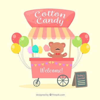 Cotton candy cart, teddy bear and balloons