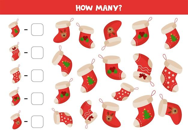 各クリスマスの靴下を数え、その数を箱に書き留めます。子供のための教育数学ゲーム、