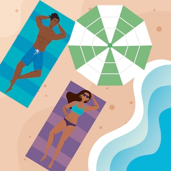 Couple afro with swimsuit lying down tanning on the beach, summer vacation season