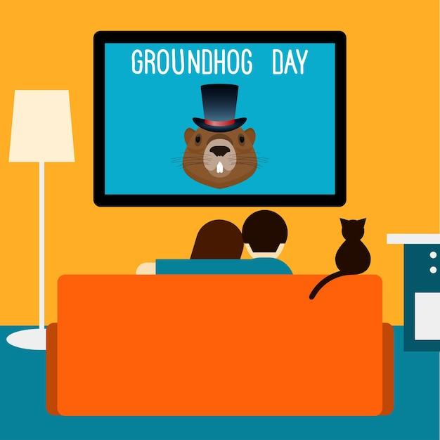 커플과 고양이는 방에 있는 소파에 앉아 텔레비전을 보고 있습니다. 그라운드호그 데이 테마 카드 템플릿입니다.