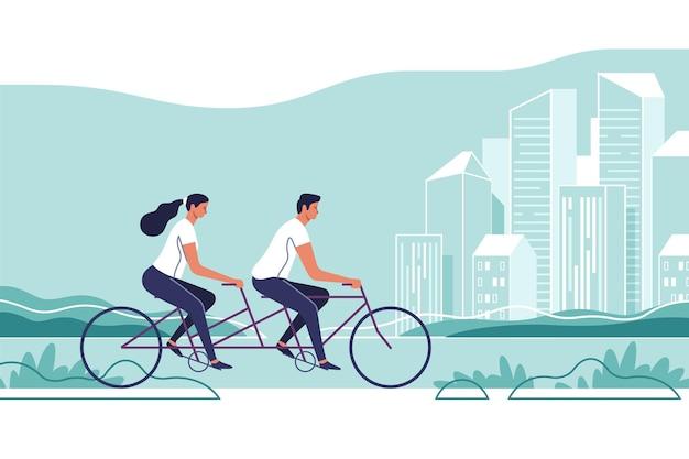 부부는 도시 풍경 배경에 자전거를 타고있다
