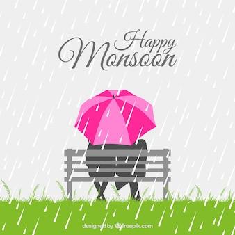 Пара фон с зонтиком, сидя на скамейке