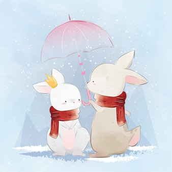 Couple bunny under umbrella